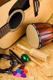 Set of various music instruments on OSB board Royalty Free Stock Image