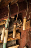 Set of various old rusty sickles, hanging in a shed Stock Photography