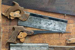Set of various old and used hand saws Stock Photography