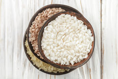 Set various  organic raw rice on a wooden white table in ceramic. Bowls. Devzira. Arborio. Selective focus Stock Photo