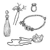 Set of various ornamentations: a ring, a bracelet, a pendant, a hairpin, a keychain with a tassel vector illustration