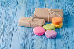 Set of various pastel colored macaroon and gift boxes with ribbo Royalty Free Stock Photo