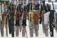Set of various penknives. On open market Royalty Free Stock Image
