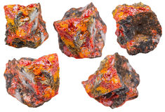 Set of various realgar crystals on rocks isolated Stock Photos