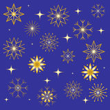 Set of Various Snowflakes. Golden Shimmering Stars and Snowflakes on Blue Background.  Elements for Christmas and New Year Design Royalty Free Stock Photo
