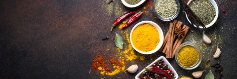 Set of Various spices on dark stone table. Long banner format stock images