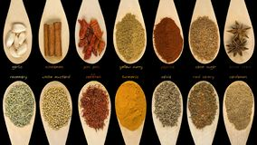 Set of various spices and food ingredients with labels isolated on black background. High resolution.  stock photo