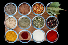 Set of various spices on wooden plank Royalty Free Stock Photo