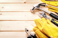 Set of various tools on wooden background Royalty Free Stock Image