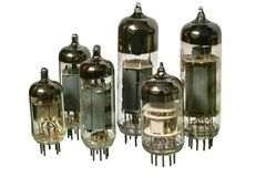 Set of varisized old vacuum radio tubes. Royalty Free Stock Photography