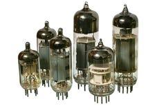 Set of varisized old vacuum radio tubes. Varisized glass vacuum radio tubes. Isolated image on white background Royalty Free Stock Photography