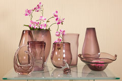 Set of vases on glass table Stock Photo