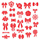 Set vector bows of different shapes red color. Royalty Free Stock Images