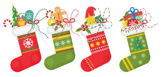 Set of vector Christmas socks in red andd green colors with various patterns. Christmas stocking collection. Stock Image