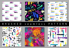 Set of Vector colorful seamless pattern with brush strokes and dots. Pink blue yellow green color on black background Royalty Free Stock Photos