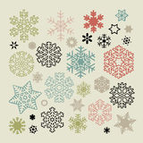 Set of vector colorful snowflakes icons on beige background Royalty Free Stock Photos