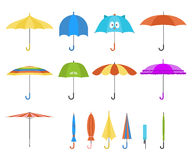 Set of vector cute multicolor umbrellas in flat design style. Closed and open fashion icons. Cover accessory. Modern Stock Photos