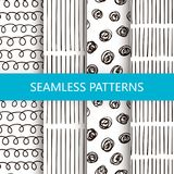 Set of vector doodle patterns with circles and lines. Black and white seamless backgrounds. Set of vector doodle background with circles and lines. Black and Royalty Free Stock Image