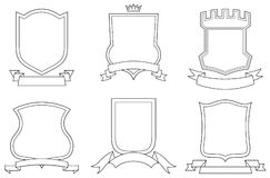 Set of vector emblems, crests, shields and scrolls Stock Images