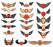 Set of the vector emblems with wings Stock Images