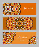 Set of vector ethnic banners. Set of horizontal banners with decorative narrow circular ethnic elements, orange red brown beige black, vector illustration Royalty Free Stock Photos