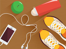 Set of vector fitness equipment. Minimal flat illustration. Sneakers, bottle of water, headphones and phone, apple on the wooden f Royalty Free Stock Photos
