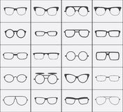 Set of vector glasses icons in black over white Stock Images