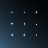 Set vector glowing stars. On a black background Stock Images