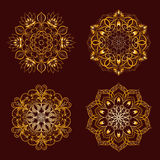 Set from Vector Gold Color Mandala over dark brown Stock Photos