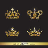 Set of vector gold crown icons. Logo royal design elements Stock Images