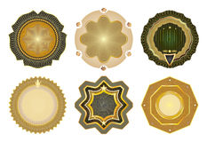 Set of vector gold-framed labels. Stock Images