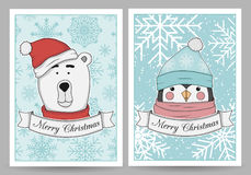 Set vector greeting card with a cartoon polar bear and a penguin. In knitted hats. The inscription Merry Christmas on a white ribbon. Happy New Year Royalty Free Stock Photos