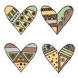 Set of vector hand drawn decorative stylized childish hearts. Doodle style, tribal graphic illustration. Ornamental cute hand draw Stock Photos