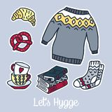 Set of Vector hand drawn stickers. Hygge and cozy things like a warm wool sweater, socks, , tea, books. Danish living concept Stock Photo