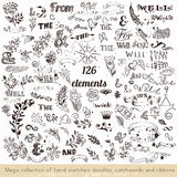 Set of vector hand sketched doodles, catchwords and ribbons Stock Images