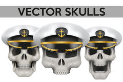 Set of Vector Human skulls with Captain peaked cap Stock Photography