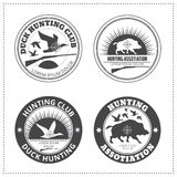Set of vector hunting club emblems with a wild hog and a wild du Stock Image