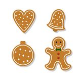 Set of gingerbread. Set of vector icons of Christmas ginger bread cookies. Gingerbread men and  heart, bell and other holiday symbols, baked by hand. Festive Stock Photos