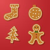 Set of gingerbread. Set of vector icons of Christmas ginger bread cookies. Gingerbread men and other holiday symbols, baked by hand. Festive baking for winter Royalty Free Stock Photography