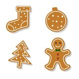 Set of gingerbread. Set of vector icons of Christmas ginger bread cookies. Gingerbread men and other holiday symbols, baked by hand. Festive baking for winter Royalty Free Stock Image