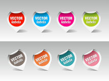 Set of vector labels. Set of partially peeled colorful vector labels on light background Stock Images