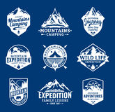 Set of vector mountain and outdoor adventures logo. Tourism, hiking and camping labels. Mountains and travel icons for tourism organizations, outdoor events Stock Photography