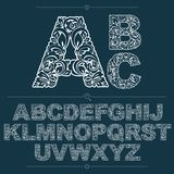 Set of vector ornate capitals, flower-patterned typescript. Blac. K and white characters created using herbal texture Royalty Free Stock Image