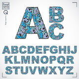 Set of vector ornate capitals, flower-patterned typescript.. Blue characters created using herbal texture Royalty Free Stock Photos
