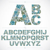 Set of vector ornate capitals, flower-patterned typescript. Colo. Rful characters created using herbal texture Stock Photos
