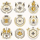 Set of vector retro vintage insignias created with design elemen. Ts like medieval castles, armory, wild animals, imperial crowns. Collection of coat of arms Royalty Free Stock Image
