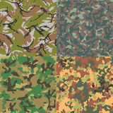 Set of vector seamless camouflage patterns. Four Royalty Free Stock Photo