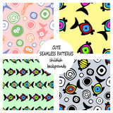 Set of vector seamless decorative pattern with hand drawn fish, starfish, octopus. Cute childlike backgrounds. Template for wrappi. Ng, fabric, cover. Series of Royalty Free Stock Photos