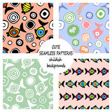 Set of vector seamless decorative pattern with hand drawn fish, starfish, octopus. Cute childlike backgrounds. Template for wrappi Stock Photography