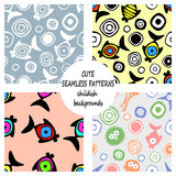 Set of vector seamless decorative pattern with hand drawn fish, starfish, octopus. Cute childlike backgrounds. Template for wrappi. Ng, fabric, cover. Series of Stock Photo